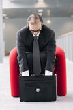 Business man searching for something in his briefcase Royalty Free Stock Photography