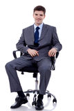 Business man seating on chair Royalty Free Stock Photo