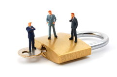 Business man on security padlock Stock Image