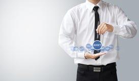 Business man select asset Stock Photos