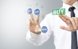Business man select buy asset Royalty Free Stock Photo
