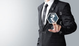 Business man select India Rupee. Money or currency for investment Stock Photos