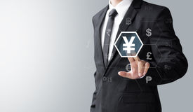 Business man select Japan Yen. Money or currency for investment Stock Photo