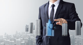 Business man select modern building. And real estate for investment Stock Photo