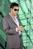 Business man sending sms Stock Photography