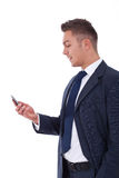 Business man sending a text with his phone Royalty Free Stock Images