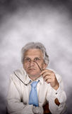 Business man. Senior business man with glasses on meeting Royalty Free Stock Image