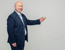 Business man senior portrait pointing finger Stock Photos