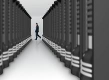 Business man in a server room Stock Photo