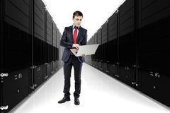 Business man with servers in the background Stock Photo