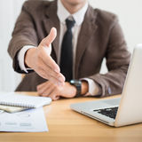 Business man shake hand and greeting you. Royalty Free Stock Photos