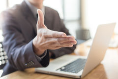 Business man shake hand and greeting you.  Stock Image