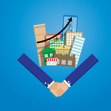 Business man shake hand with group of real estate building Stock Images