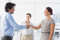Business man shaking colleagues hand Stock Images