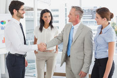 Business man shaking colleagues hand Royalty Free Stock Image