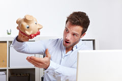 Business man shaking empty piggy Royalty Free Stock Images