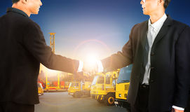 Business man shaking hand with successful agriment in container Stock Image