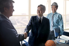 Business man shaking hand after successful project solution planing meeting shot in working office Stock Image