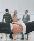Business man shaking hand to partner Stock Photo