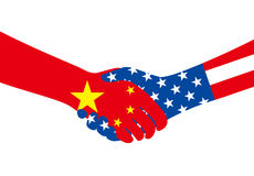 Business man shaking hands, china and american national flags Royalty Free Stock Photos