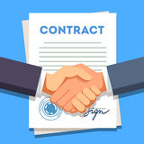 Business man shaking hands over a signed contract Stock Photography