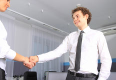 Business man shaking hands with a woman in the off Stock Image