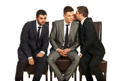 Business man sharing a secret. Business men sharing a secret to his colleague and the other trying to hear isolated on white background stock photos