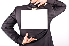 Business man with a sheet on the back stock photo