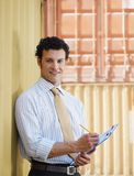 Business man with shipping containers Stock Image