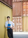 Business man with shipping containers Stock Photos