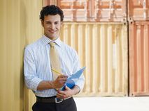 Business man with shipping containers Royalty Free Stock Photos