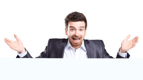 Business man with shocked expression presenting Stock Photography