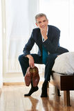 Business man with shoes in hotel room Royalty Free Stock Images