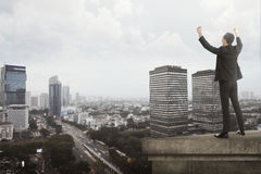 Business man shout on the building rooftop Stock Photos