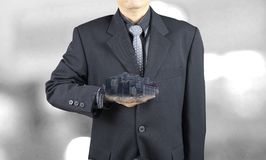 Business man show building in his hand royalty free stock images