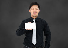 Business man show a contact card Royalty Free Stock Photography