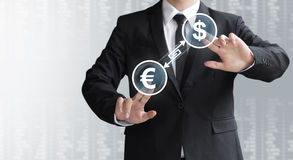 Business man show currency converter or exchange Royalty Free Stock Images