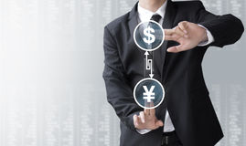 Business man show currency converter or exchange Stock Photo