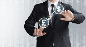 Business man show currency converter or exchange Royalty Free Stock Photos
