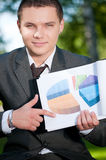 Business man show graph at park.  Stock Image