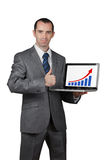 Business man show his laptop screen. And thumb up Royalty Free Stock Photography
