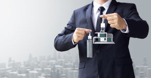 Business man show key house and modern building. Real estate for investment Stock Images