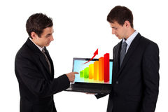 Business man show on laptop with chart 2 Stock Images