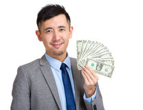 Business man show money Royalty Free Stock Images
