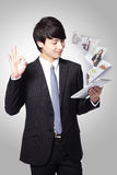 Business man show ok and using tablet pc Royalty Free Stock Photo