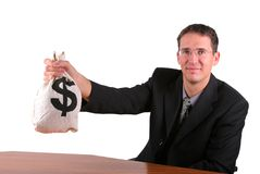 Business man show proudly his money bag Royalty Free Stock Image