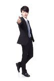 Business man show thumb up in full length. Young handsome business man show thumb up in full length isolated on white background, asian model Stock Photos