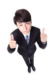 Business man show thumb up in full length. Young handsome business man show thumb up in full length isolated on white background, high angle view, asian model Royalty Free Stock Photos