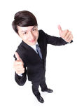 Business man show thumb up in full length. Young handsome business man show thumb up in full length isolated on white background, high angle view, asian model Royalty Free Stock Photography