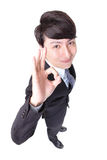 Business man show thumb up in full length. Young handsome business man show ok hand sign in full length isolated on white background, high angle view, asian Stock Photography
